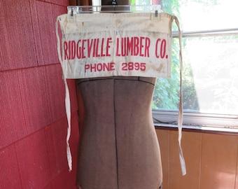 Vintage 1950s cotton apron tool painter carpenter red lettering Ridgeville Lumber Co. phone 2895