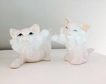 Pair of vintage playful kitten figurines