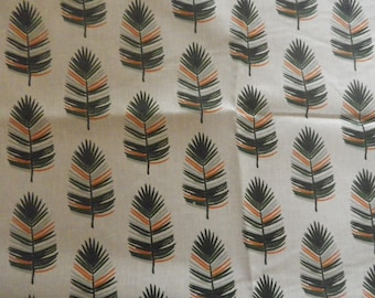 "fabric ""feathers"" on a beige background"