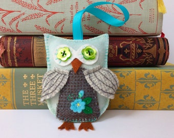 mint green hand dyed wool felt owl with green button eyes and hand embroidery