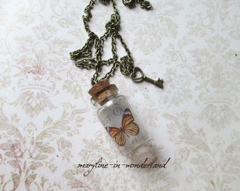 Tan Butterfly vial necklace