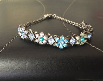 Silver bracelet with turquoise flowers