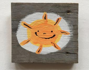 sun hand painted on reclaimed wood