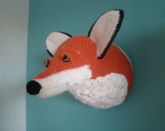 Head of fox in the hook for wall decoration