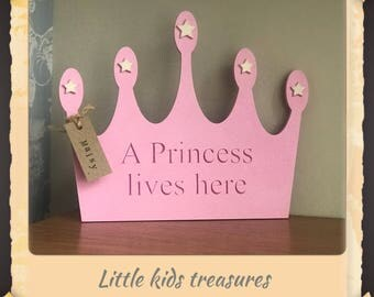 A princess lives here. Wooden sign/plaque pink crown hand crafted by little kids treasures. Personalised
