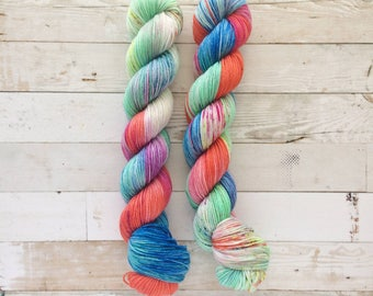 clowning around - half skein | akame sock | hand dyed yarn | red blue mint speckles | 75/25 SW Merino/Nylon fingering