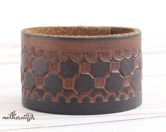CUSTOM HANDSTAMPED brown leather cuff with design by mothercuffer