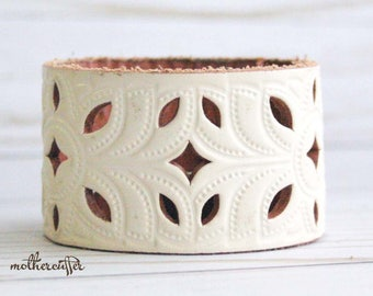 CUSTOM HANDSTAMPED off white leather cuff with cut out design by mothercuffer