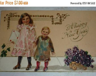 ON SALE Little Girls Pulling Carts of Violets Antique New Year Postcard
