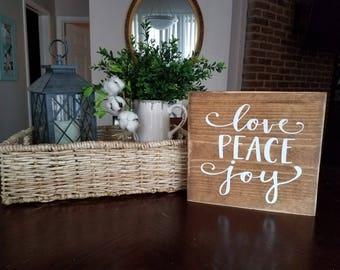 Love Peace Joy sign