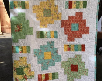 Baby quilt in red, yellow, green, turquoise, moda fabrics