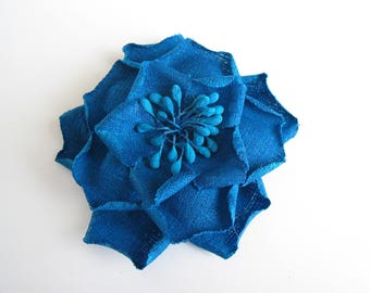Application of matte blue fabric flower brooch