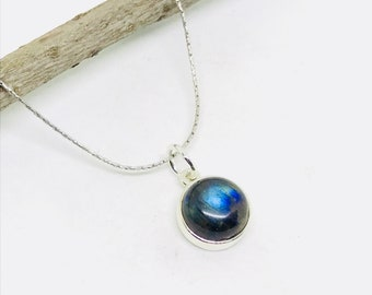 Labradorite Pendant set in sterling silver (92.5). Length- 1/2 inch long 13mm round.