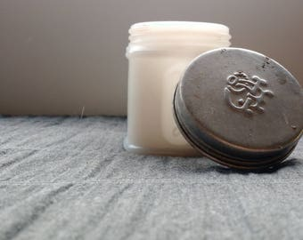 Pond's milk glass cold cream jar w/ embossed insignia lid