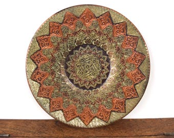 Beautiful vintage copper plate or charger with detailed decorative etched design