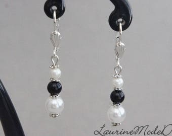 White pearls and black earrings