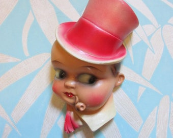 1930s/40s chalkware boy string holder with top hat & pipe
