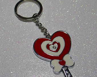 WORN SILVER KEY AND RED