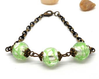 Bronze pearl bracelet white with green border