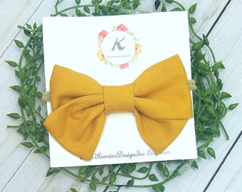 Mustard yellow nylon headband, mustard yellow hand tied bow, baby girl headbands, baby hair bows, hand tied bows, fabric bows, headband, bow