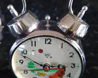 A vintage pecking chicken alarm clock in working order