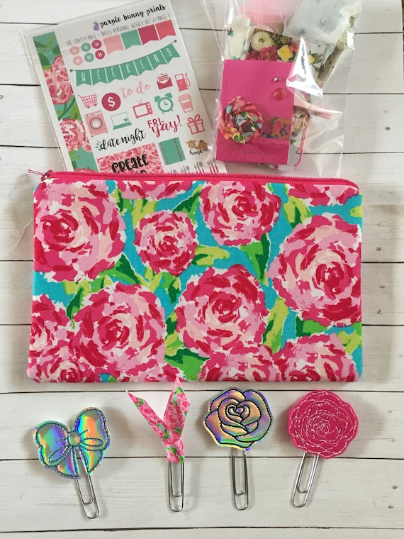 First Impressions Planner Kit* Floral Planner Clip* Floral bag* Lilly inspired fabric bag* pencil bag* Planner Stickers* Holo Planner Clips