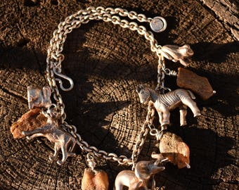 IWLF Susan Cummings wild animal huge sterling and raw baltic amber charm necklace.  Vintage rare and wonderful.