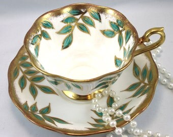 Royal Albert Teacup & Saucer,Delicate Leaf Pattern, Gilded Borders, Avon Shape, Bone English China made in 1960s