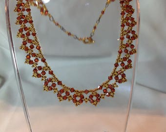 Redwood brown Swavorski Crystal necklace with golden seed beads and toggle clasp