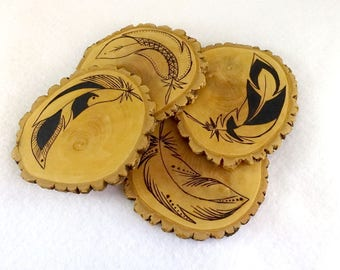 Set of 4 wooden coasters, wood slices, pyrographed ethnic feathers