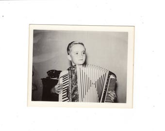 Vintage photo boy and his accordian