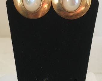 Gold plated brass circle stud earrings with oval mother of pearl stones