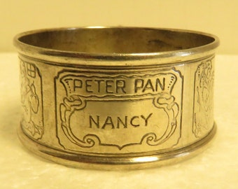 """Vintage Estate Engraved, """"Nancy"""" Sterling Silver Disney Themed Napkin Ring. The Napkin ring is in good condition. Weight 13.6 grams."""