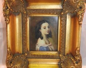antique oil painting on board of a girl,gilt ornate swept framed,glazed
