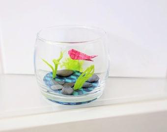 Aquarium and cute red origami fish