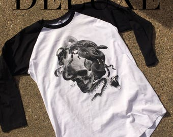 Skull and Snake tattoo inspired black and grey art hand screen printed onto deluxe baseball shirts here at Nameless City Apparel