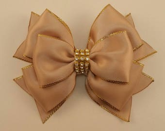 Beige satin hair bow with gold borders