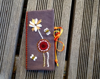 Flowers in relief and stylized Butterfly needle case