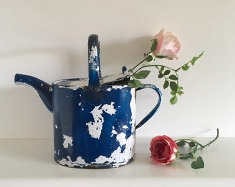 Vintage blue enamel watering can.