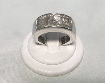 14KT White Gold 1 1/2 Ct Round and Baguette Diamond ring.