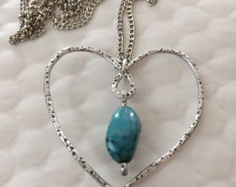 Stainless steel with Topaz in the Center heart