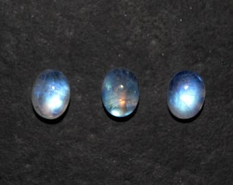 Rainbow moonstone 6*8 mm oval 3 piece with brilliant blue fire