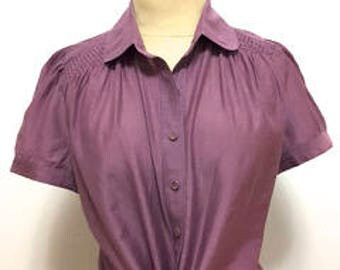 Silk blend mauve, lilac blouse with smocking yoke and puffed sleeves.
