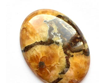 Simbircite-ammonite with silver pyrite design round cabochon.