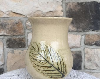 Ceramic vase with leaf imprint