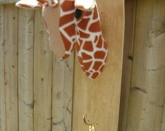 stuffed giraffe on skateboard natural