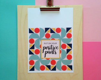 A5 motivational, modern typography print with lovely red, green, mustard yellow and navy blue pattern. 'Put on your positive pants.'