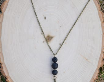Lava Bead Necklace with Feather Charm