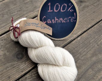 100%  Cashmere White Heavy Lace Yarn.  Over 1000 yards remainingl! Recycled yarn from a sweater. Perfect for dye base.  Dyeable Fine yarn