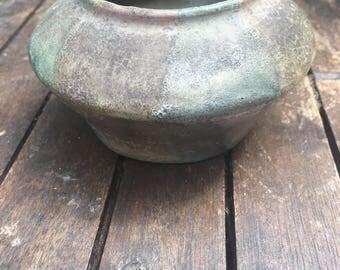 Iridescent terracotta pot